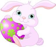 Easter Rabbit holds egg. Small lovely Easter rabbit holds Easter Egg Royalty Free Stock Photography