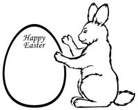 Easter Rabbit holds greeting frame in form egg Stock Photos
