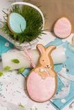Easter rabbit honey-cake, pink egg shape, green grass basket Royalty Free Stock Photography