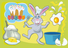 Easter rabbit making Easter Cake Royalty Free Stock Photography