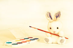 Easter rabbit with paint Stock Images