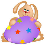 Easter rabbit with painted egg Royalty Free Stock Image