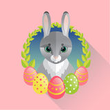 Easter rabbit with painted eggs Stock Images