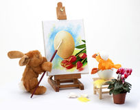 Easter Rabbit paints a picture Stock Photography