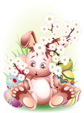 Easter Rabbit with Peach Blossoms. Cute Little Easter Rabbit with Peach Blossoms and some Decorated Eggs Royalty Free Stock Images