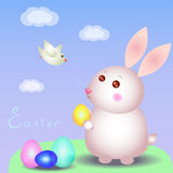 Easter rabbit and pigeon. Easter bunny holding a golden egg, white bird flies Stock Image