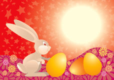 Easter Rabbit in red. Easter rabbit with eggs ready for Easter Holiday on red background Stock Photo