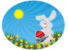 Easter rabbit with red egg (Easter postcard) Royalty Free Stock Photos