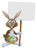 Easter rabbit with sign and eggs basket Royalty Free Stock Images