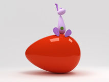 Easter rabbit on top a big red egg Royalty Free Stock Images