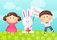 Easter rabbit with two kids. On a meadow Stock Images
