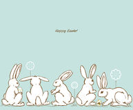 Easter rabbits. Easter white rabbits and painted eggs background Royalty Free Stock Photography