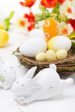 Easter rabbits and basket with eggs, close-up Royalty Free Stock Photography