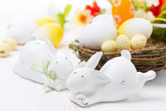 Easter rabbits and basket with eggs Royalty Free Stock Images