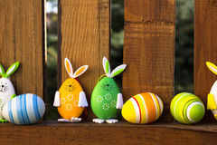 Easter rabbits bunny and eggs on the fence Royalty Free Stock Photos