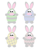 Easter Rabbits. Cute cartoon easter rabbits colored as eggs Royalty Free Stock Photos
