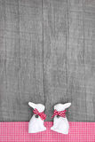 Easter rabbits decoration in interior on a wooden background in Royalty Free Stock Photo