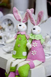 Easter rabbits decoration. Two easter rabbits. modern white rabbits as decoration on the table Stock Images