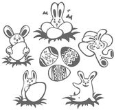 Easter rabbits and eggs Stock Photos