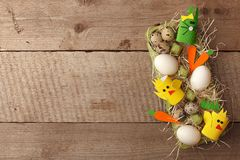 Easter rabbits and eggs decoration in interior on a vintage wooden background, springtime concept, flat lay, top view.  royalty free stock photography