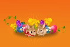 Easter rabbits with eggs and flowers background Royalty Free Stock Photos