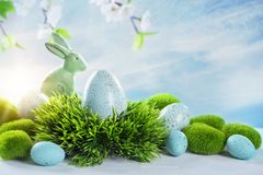 Easter rabbits and eggs. On a grey background Royalty Free Stock Photography