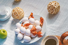 Easter ready still life. Still life with eggs, apple, cup and decoration Royalty Free Stock Photography