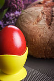 Easter red egg with bread and lilac Stock Photos