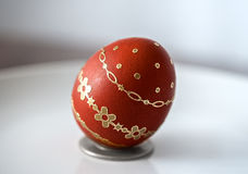 Easter red egg. With gold decoration isolated on grey background Royalty Free Stock Images