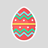 Easter red egg isolated on a gray background with colored contrasting ornament of zig zag, cut and points. Easter red egg isolated on a gray background Royalty Free Stock Photography