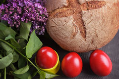 Easter red eggs with bread and lilac Stock Photo