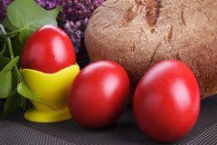 Easter red eggs with bread and lilac Royalty Free Stock Image
