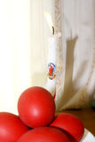 Easter red eggs and candle Royalty Free Stock Image