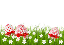 Easter red eggs on green grass Stock Image