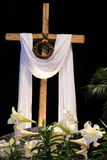 Easter Resurrection - Lilies, Cross and Crown of Thorns. White Easter lilies, a wooden cross and symbolic Crown of Thorns signifying the death and resurrection Stock Photos
