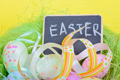 Easter ribbon with eggs and board Royalty Free Stock Image