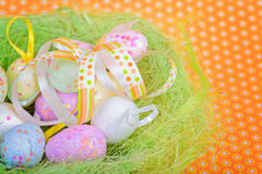 Easter ribbon and eggs in nest Royalty Free Stock Image
