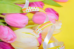 Easter ribbon with pink tulips Royalty Free Stock Photos