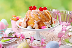 Easter ring cake with cherry decoration and icing sugar stock photography