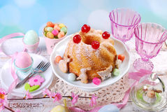 Easter ring cake with cherry decoration and icing sugar royalty free stock photo