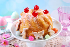 Easter ring cake with cherry decoration and icing sugar Royalty Free Stock Image