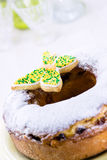 Easter ring cake with icing sugar and colorful butterfly Royalty Free Stock Images
