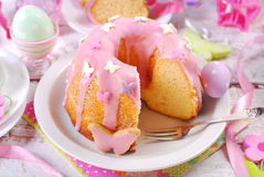 Easter ring cake with pink icing and butterfly shaped sugar spri Stock Image
