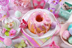 Easter ring cake with pink icing and butterfly shaped sugar spri Stock Photography