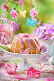 Easter ring cake with pink icing and butterfly shaped sugar spri Royalty Free Stock Photo