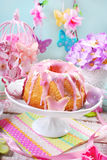 Easter ring cake with pink icing on the top Royalty Free Stock Photos