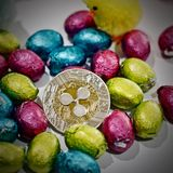 Easter ripple coin. Digital currency physical metal ripple coin. Cryptocurrency easter concept royalty free stock photos