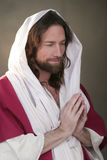 Easter Risen Prayer Hands Stock Photo