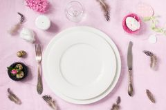 Easter romantic dinner. Elegance table setting spring pink flowers on pink linen tablecloth. Top view. Elegance table setting spring pink hyacinth flowers on Stock Images