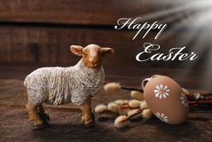 Easter rustic decoration with lamb and egg on wooden background Stock Image